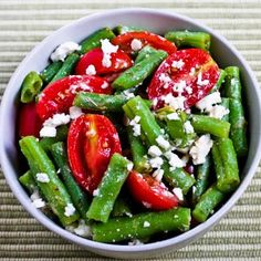 If you have garden beans or good fresh green beans from the store, please make this salad with green beans, tomatoes, feta, and a tangy dressing!