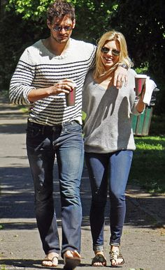 Mollie King and David Gandy hold hands on romantic London stroll #dailymail