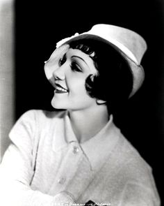 Claudette Colbert Posed Side view in White Polo shirt with Hat Premium Art Print