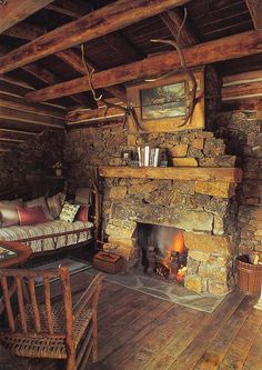 This simple, rustic cabin fireplace invites you to linger. Cabin Fireplace, Rustic Fireplaces, Stone Fireplaces, Fireplace Ideas, Airstone Fireplace, Primitive Fireplace, Rustic Mantle, Fireplace Facade, Fireplace Modern