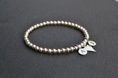 Sterling Silver Letter and Heart Charm Stretch Bracelet by ShineAndBeHappy on Etsy