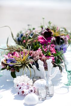A wild seafloor inspired centerpiece for this beachside tablescape.  Design by Alchemy Fine Events