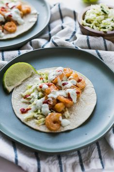 Spicy shrimp and cabbage slaw topped with avocado lime crema and a drizzle or two of sriracha sauce. This combination creates the best shrimp taco you've eaten so far. Shrimp Marinade, Shrimp Tacos, Spicy Shrimp, Cabbage Slaw, Green Cabbage, Shrimp Taco Recipes, Mashed Avocado, Sriracha Sauce, Sugar