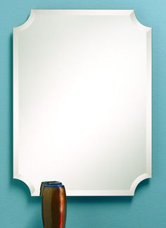 333 – Rectangle frameless mirror features clipped corners and 1″ beveled edge.24″ wide, 32″ high and 3/8″ deep.