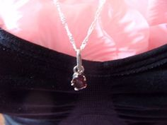 "New Listing Started tiny silvertone pendant with deep red stone on new fancy 23""L chain marked 925 £0.85"