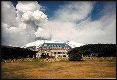 Mt Ruapehu erupting 1996 NZ. An eruption cloud from New Zealand Mt. Ruapehu dwarfs 'The Chateaux' lodge, in the foreground. The building shook at Waikaremoana DOC when this happened, we thought it was an earthquake!