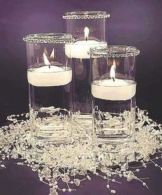 Like the crystals to break up the base and simple floating candles with a little bling at top, no fillers so super easy. Floating Candle Centerpieces, Wedding Centerpieces, Wedding Bouquets, Modern Centerpieces, Winter Centerpieces, Centerpiece Ideas, Wedding Flowers, Wedding Dresses, Winter Wonderland Decorations