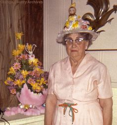 Easter...Grandma...you look super nice...a little confused but very festive. Did someone in the family make you wear that hat. It is not a good look...they took your picture, so it looks like that thing on the wall, is coming out of your hat!