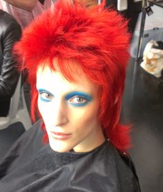 Jean Paul Gaultier totally took it back to the 80's with a salute to his favourite pop icons for his S/S 2013 collection. Check out this amazing Ziggy Stardust makeup by International artist Stephane Marais. Love the acqua rimmed eyes. David Bowie for Halloween anyone?