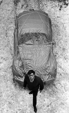 "Christo with ""Wrapped Car (Volkswagen), 1963"""