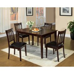 This chic dining set will blend smoothly with many decors. The simple style of smooth surface dining table is accompanied by four stylish slat back design dining chairs that offer hours of comfort with their padded leatherette seats.