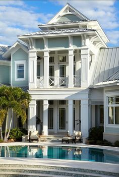 Sophisticated Coastal Home ~ blue paint color!! look at stone/cement at foundation.