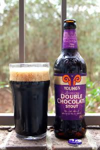 Young's Double Chocolate Stout. OK, first things first: It's got a pretty purple label! <3 Nice thick head, with a nice chocolate, toffee, toasty oatmeal smell. Not a lot of chocolate flavor, but a light body, so it is very drinkable. And it has a nice creamy mouthfeel. Nice for sipping.