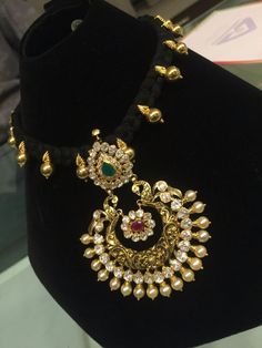 Black threaded necklace has become a must have jewellery piece in SouthIndian women& jewellery collection. I like the idea of it as it ne. Gold Necklace Simple, Simple Jewelry, Emerald Necklace, Gold Earrings, Thread Jewellery, Gold Jewellery Design, Temple Jewellery, Pendant Jewelry, Beaded Jewelry