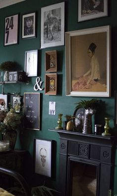 The Girl with the Green Sofa. Dark and moody interiors. Green gallery wall inspiration.