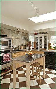 Like the checker floor with the two tone cabinets its Marmoleum