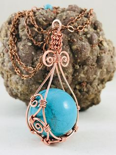 32 adjustable copper wire wrapped turquoise sphere pendant wire wrapped into a teardrop shape. A unique pendant that will add flare to any outfit. ****CUSTOM ORDERS WELCOME***** Do you have a special gemstone you would like to keep near. My special whimsical wire wrapping offers a fun