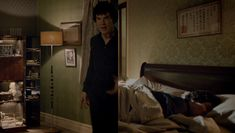 Hanging above Sherlock's bed is a traditional Judo certificate, with his name added - シャーロック・ホームズ.