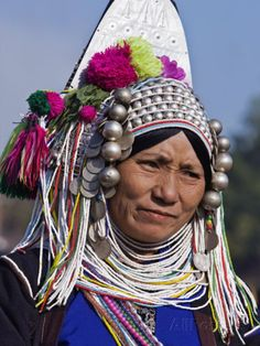 Burma, Kengtung, A Mong La Akha Woman Wearing a Traditional Headdress of Silver and Beads, Myanmar Photographic Print by Nigel Pavitt at AllPosters.com