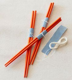 Chopstick Bundles  Dress up the party utensils with a scrap of paper and twine. Our chopsticks were cheap, and they'll incite dinner conversations as guests dig into their meal.