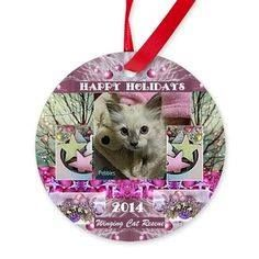 Another gorgeous ornament for the holiday season! All proceeds help WCR with vetting and low cost spay/neuter clinics! 2014 Winging Cat Rescue Round Ornament ~ http://www.cafepress.com/smpab.1423368445