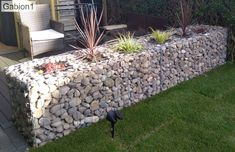 Planters inserted into gabion1 wall Bath Surround, Gabion Baskets, Gravel Landscaping, Gabion Wall, Outdoor Baths, Rock Wall, Planters, Patio, Landscape