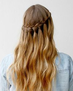 This simple waterfall braid is a gorgeous hairstyle for long hair. With it's intricate appearance, this is a great prom hair idea because it allows your hair to have beautiful cascaded curls while still being styled.