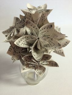 A personal favorite from my Etsy shop https://www.etsy.com/listing/250435920/paper-flower-sheet-music-origami
