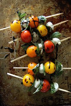 Grilled Caprese Kebabs by heatherchristo:All the ingredients of a simple summer caprese salad, heated up on a smoky grill until the cheese is gooey and melting and the tomatoes are juicy and hot and bursting with sweet flavors. These are easy to prepare ahead of time and then just quickly grill at the last moment to enjoy at the table. #Appetizer #Skewers #Caprese #Tomatoes