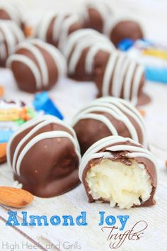 Almond Joy Truffles - Taste better than real Almond Joys!  ANYONE WANT TO MAKE THESE FOR ME???  Thanks, Angie.  :D