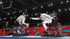 Veronika Juhasz (R) of Hungary and Delphine Bernard (L) of France compete during the women's Individual Foil Cat A preliminaries of the Wheelchair Fencing