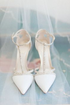Stylish wedding shoes idea - pointed toe sandals ivory white with silver detailing for a perfect spring summer wedding
