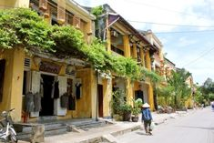 Hoi An is a peaceful and lovely little town on coast of central Vietnam. Hoi An Old Town offers the special things which you can not find in any where else Hoi An Old Town, Local Tour, Colonial Architecture, Da Nang, Covered Bridges, Vietnam Travel, Hanoi, Budget Travel