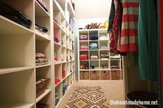 With a shelving system, a patterned rug, and a bright coat of paint, this family closet is now organized and lively. See the full transformation at The Handmade Home. RELATED: 8 Easy Ideas to Organize Your Linen Closet Linen Closet Organization, Home Organisation, Closet Storage, Organization Ideas, Bathroom Storage, Kitchen Organization, Fridge Storage, Small Bathroom, Family Bathroom