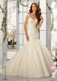 Wedding Gowns By Blu featuring Alencon Lace Appliques with Frosted Beading onto the Tulle, Mermaid Gown Colors available: White, Ivory, Ivory/Light Gold.