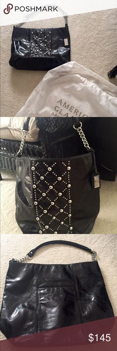 Badgely Mischka black leather bag with studs This Gorgeous bag is a re-posh. I love it but did  not ask measurements and it's just too large for me. It has amazing silver studs in a cool pattern on front. Magnetic closure. Silver chain and padded leather handle for comfort. Taupe interior, very clean. Inside has a metal clip for keys, two slot open pockets and one zip pocket. It measures 14 deep 16 wide and has approximately a 10 inch drop. I love this bag and if I still carried my lap top…
