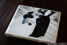 Photos on 4x4 tiles sealed in resin.