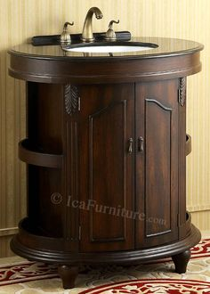 1332 circle single bath vanity cabinet with black granite top and outer storage shelves.
