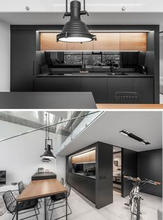 A Lithuanian Loft Interior With A Monochrome And Wood Material Palette In this modern kitchen, the upper wood cabinetry complements the dining table, contrasts the black cabinets, and adds a natural touch to the minimalist interior. Best Kitchen Designs, Modern Kitchen Design, Modern Interior Design, Interior Design Living Room, Interior Architecture, Kitchen Ideas, Monochrome Interior, Contemporary Interior, Farmhouse Style Kitchen