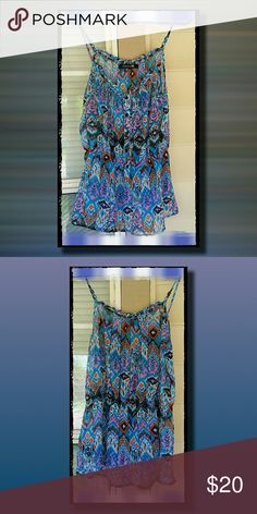 Sheer, Bohemian-designed Tank Spaghetti straps, sheer material, and a cinch around the base.  It appears that the back side is slightly shorter than the front.  The straps are adjustable, and NEVER WORN! Forever 21 Tops