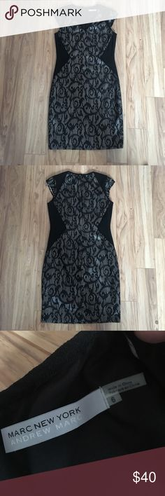Marc New York Black Lace Dress Worn once and like new, bought from Saks Fifth Avenue. Beautiful lace design over a tan metallic material. Very comfortable and flattering and some stretch to the material (2% spandex). Would pair great with nude heels Andrew Marc Dresses