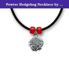 """Pewter Hedgehog Necklace by The Magic Zoo. This adorable hedgehog necklace is made for the hedgie lover both young and adult. Tiny and detailed, this is a delicate design that captures the whimsy of this popular pocket pet. The pendant measures ½"""" tall and ½"""" wide, and comes ready to wear on an 18"""" rubber cord with a Czech glass bead on either side of the piece."""