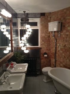 Matt from Walton on Thames created a industrial style bathroom with exposed brick and hanging lights Pallet Wall Bathroom, Small Bathroom Tiles, Bathroom Plumbing, Industrial Bathroom, Modern Bathroom, Bathroom Faucets, Home Heating Systems, Small Shower Room, Bathroom Trends