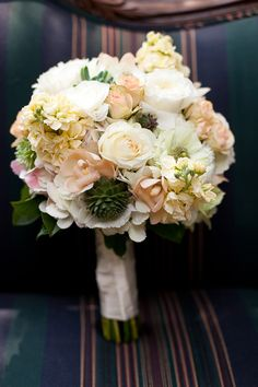 white, peach, pink understated bouquet complete with succulents