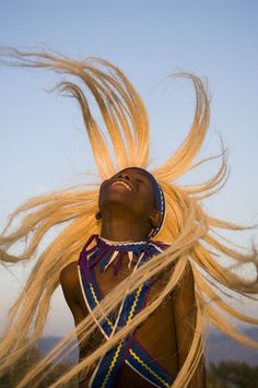 Intore dancer flicking his hair.