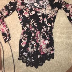 Romper black with flowered detailing! Only worn once! Got to short when I got taller! Wet Seal Dresses