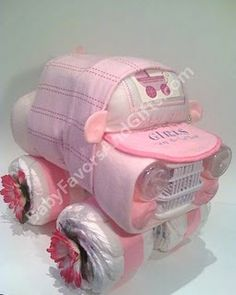 DIY Gift: Diaper Jeep (recieving blankets, bottles, bib, diaper, bottle dishwashing cage, flowers, ribbon, etc.). Too cute! #diy #craft #baby #shower #gift