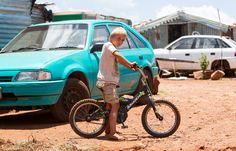 Old cars sit next to the flimsy shelters and makeshift toilets in the camp where families are forced to survive on less than a month Car Sit, The End Game, Apartheid, Slums, Top Photo, Kids Playing, South Africa, Camping, Families
