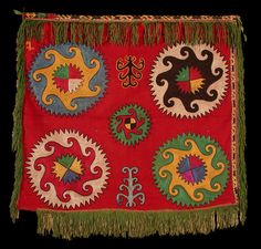 """suzani: Lakai silk embroidered """"ilgitsch"""", nomadic tribe of Central Asia, Uzbekistan, 19th C. Silk embroidery on wool mounted on cotton panel. Solar symbols of Sun with stylistic scorpions in ornaments. In the upper left corner you may find symbol small dog."""