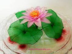 Potted landscape. Pink white Lotus, one golden fish and Vintage Inspired white swan. Handmade Nylon Flower and leave. Home Decor Gift. Lotus flower means is Pure, clean and Faithful, pink lotus means happy sweet. Flower size approximately 5 inches (12.75cm) in diameter and 2 inches